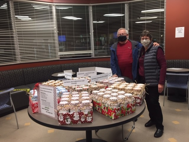 Michael and Susan Covey bring Christmas treats to the staff at PRCS.
