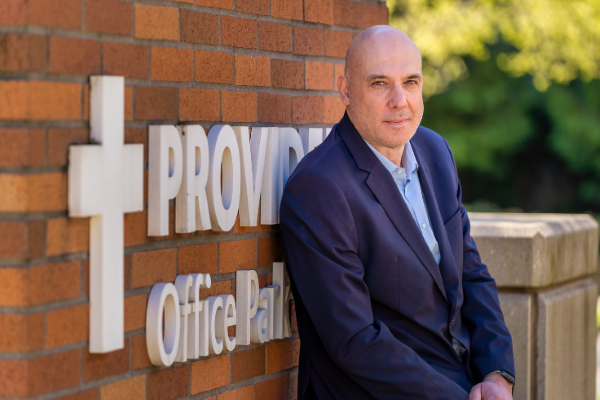 Carlo Bifulco, Providence medical director, stands outside of a Providence administrative building.