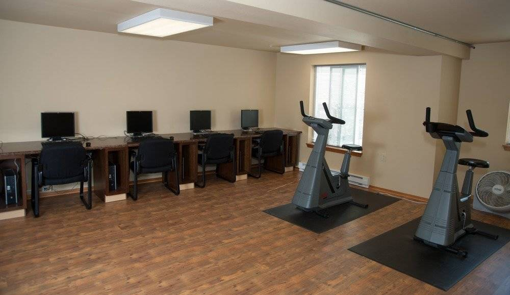 Computer room with workout machines