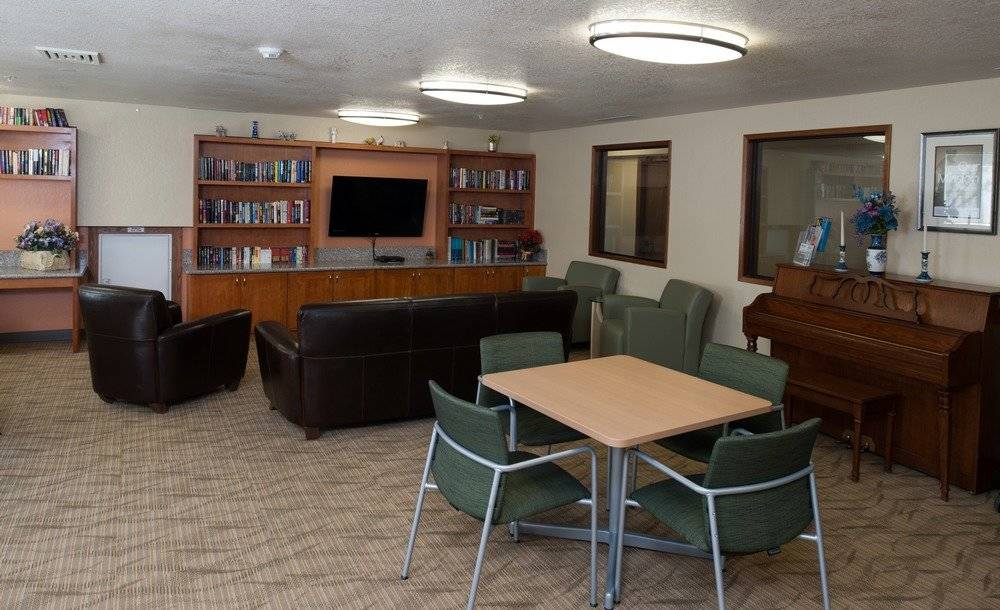 Community room with furniture and TV