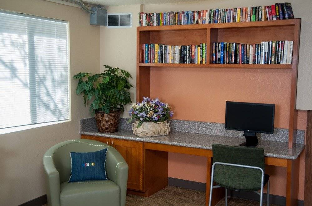 Community room with books and a computer