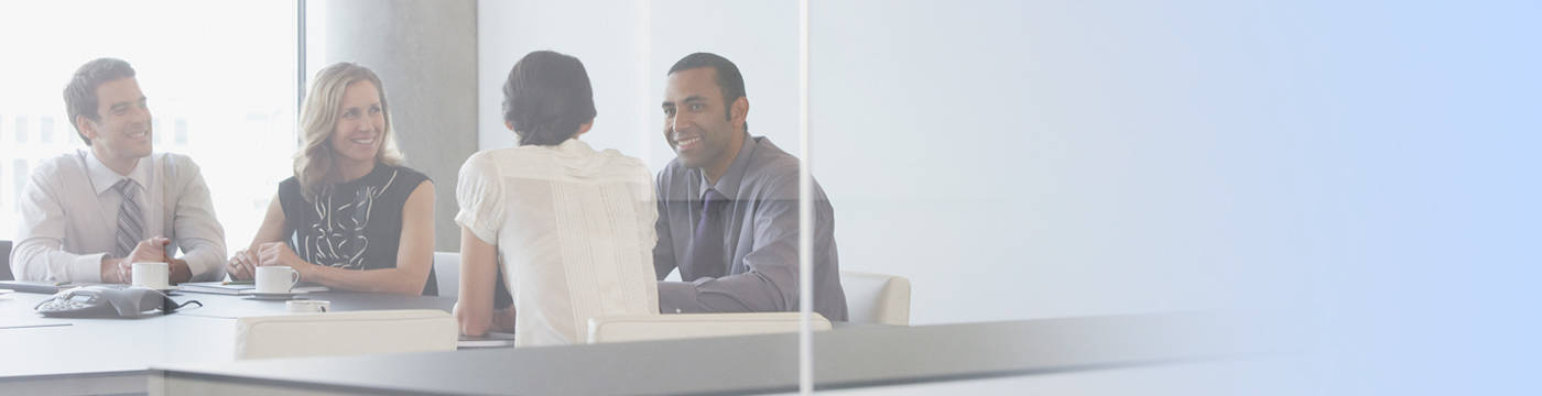 Group smiling in conference room