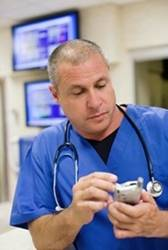 A physician accesses the Providence patient referral tool.