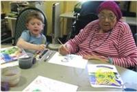 Resident painting with child