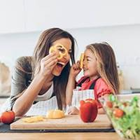mother and daughter cooking healthy meal
