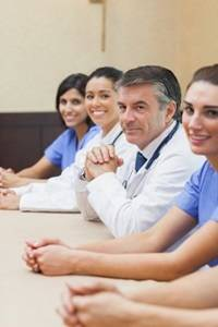 Doctors attend a Grand Rounds presentation.