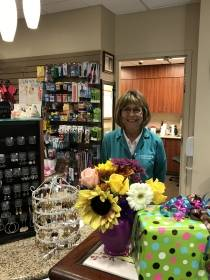 Volunteer working at SJHE gift shop