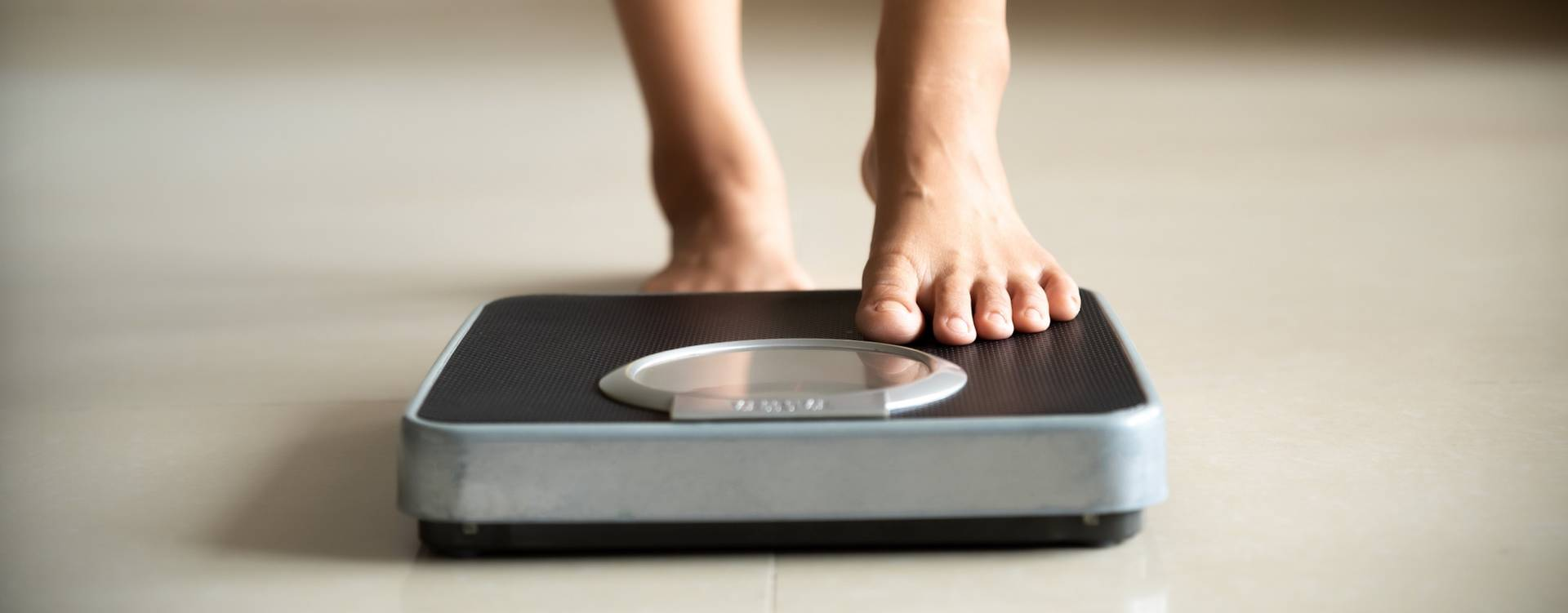 woman-stepping-on-scale