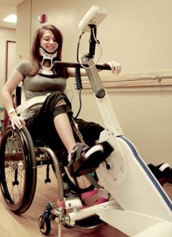 woman using Functional Electrical Stimulation (FES) Therapy Bike