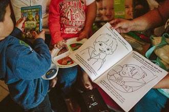 Kids looking at health coloring book
