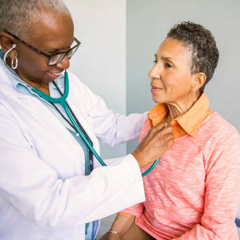 Doctor listening to patients heart and lungs