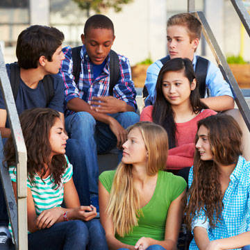 Group of diverse teenagers talking