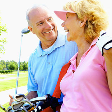 Middle age couple golfing