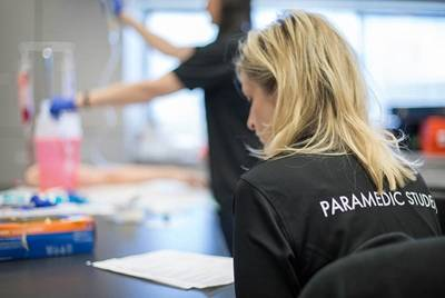 Paramedic student seated at desk