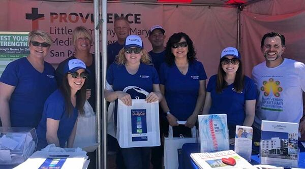 Group shot of Providence caregivers working at the Palos Verdes Chamber Street Fair