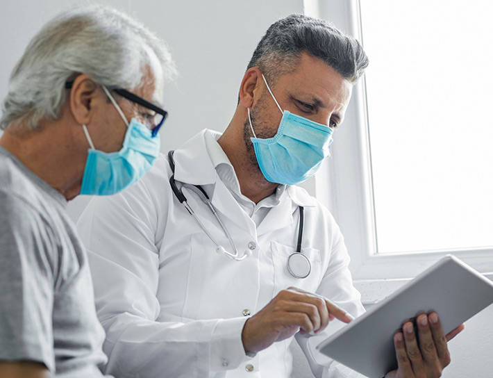 doctor and patient looking at ipad