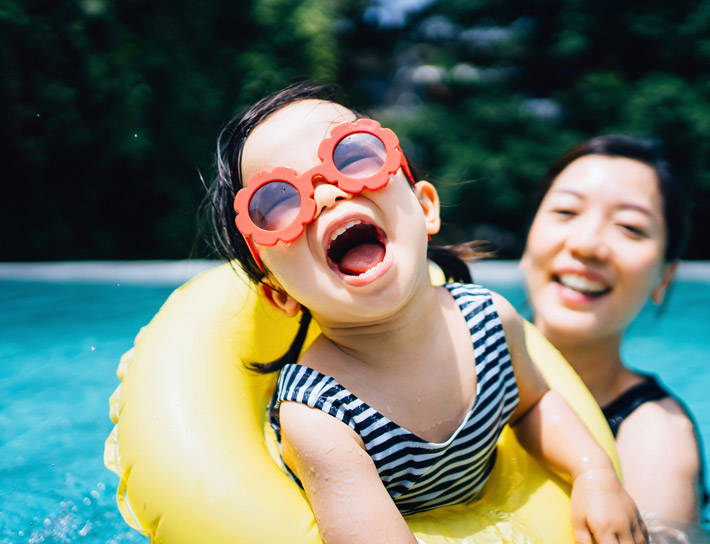 Girl with mom at pool