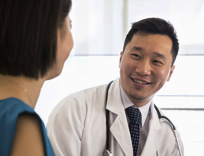 Female patient consulting with a doctor