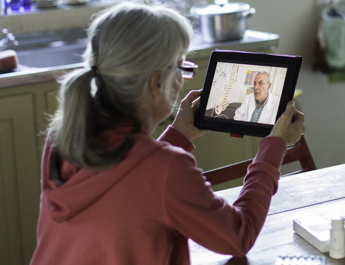 Woman having a virtual visit with doctor