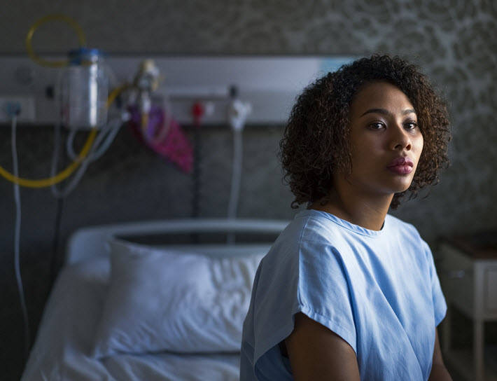 Woman sitting in hospital room