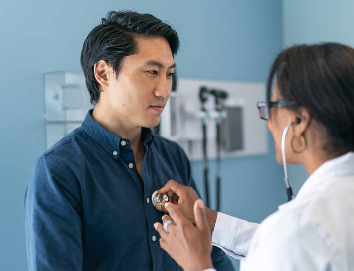 Doctor examining a male patient