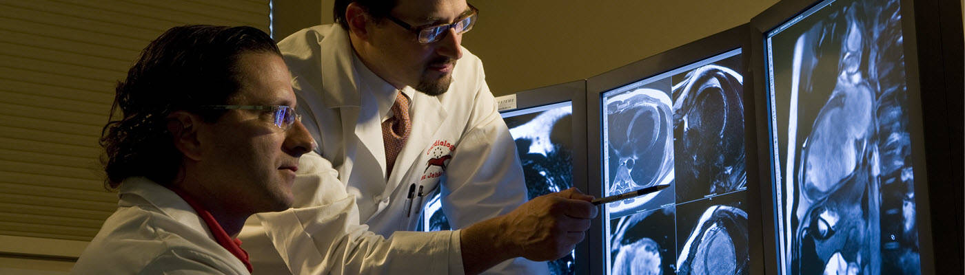 Doctors reviewing cardiac scans on computer