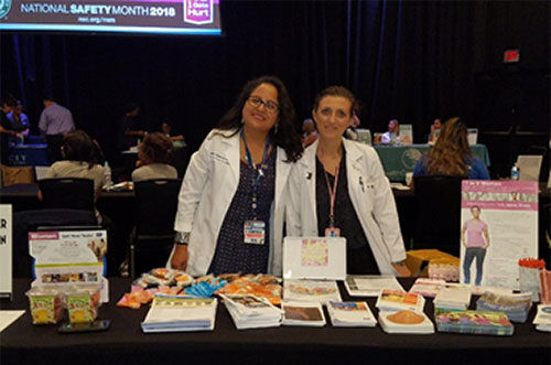 Two nurses working a booth
