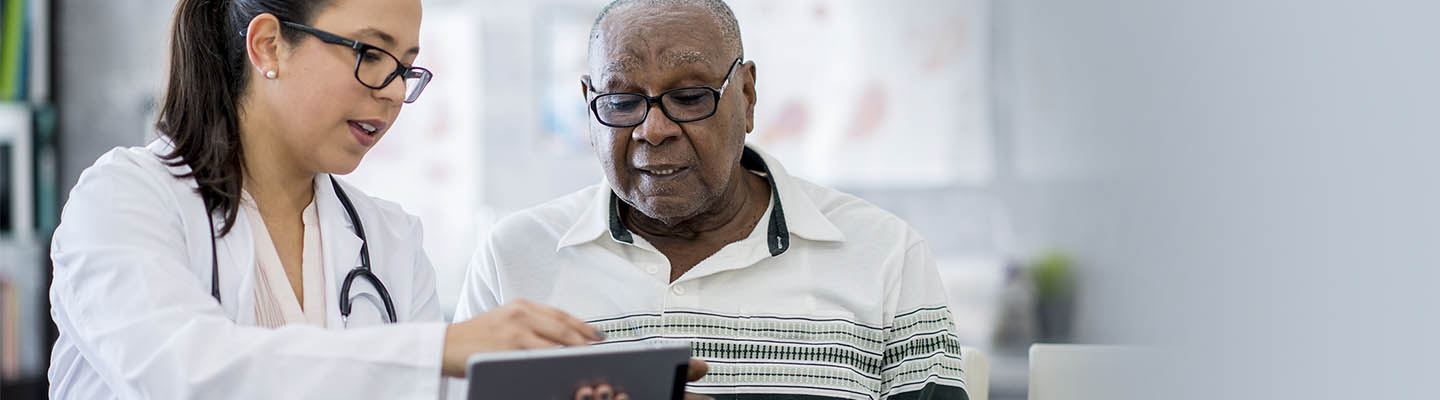 provider sharing view of tablet with patient