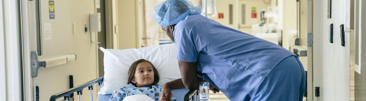 Doctor holding young girl before surgery