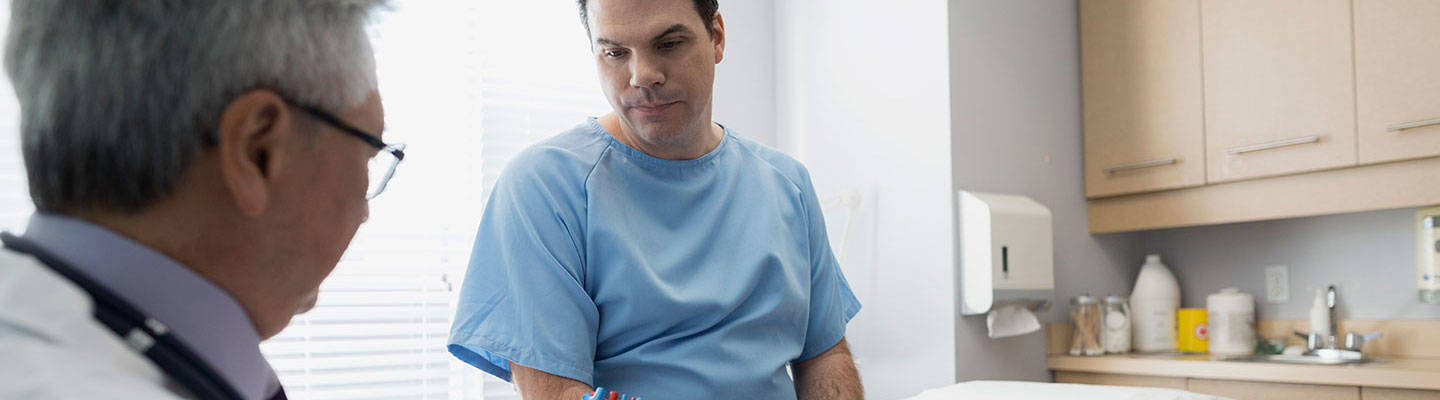 A cardiologist consults with a heart surgery patient.