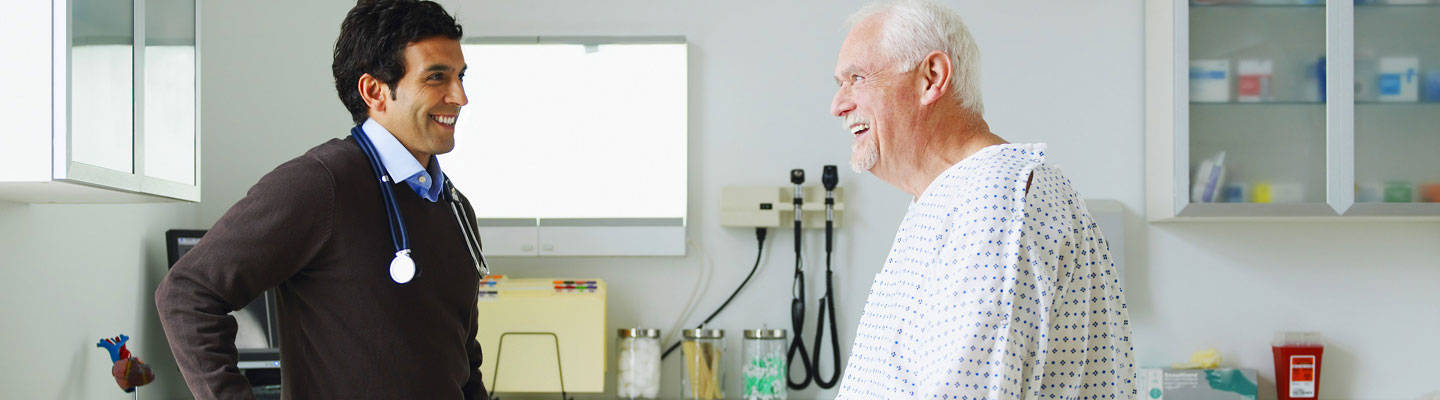 Male provider with senior patient