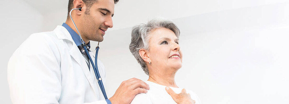 Doctor checking on patient's lungs