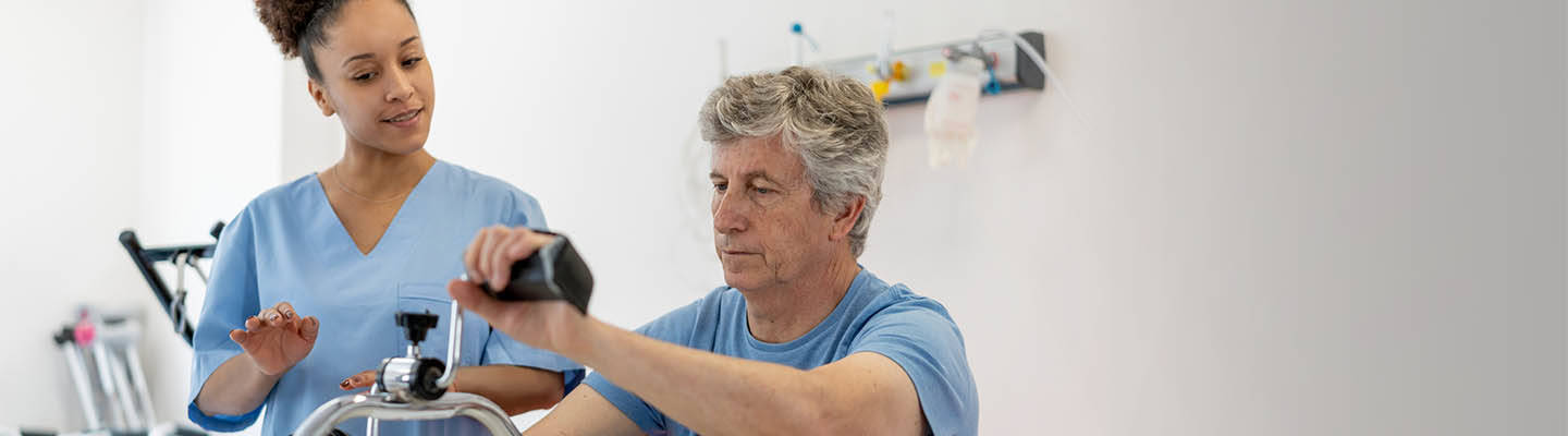 man in occupational therapy exercising his arms