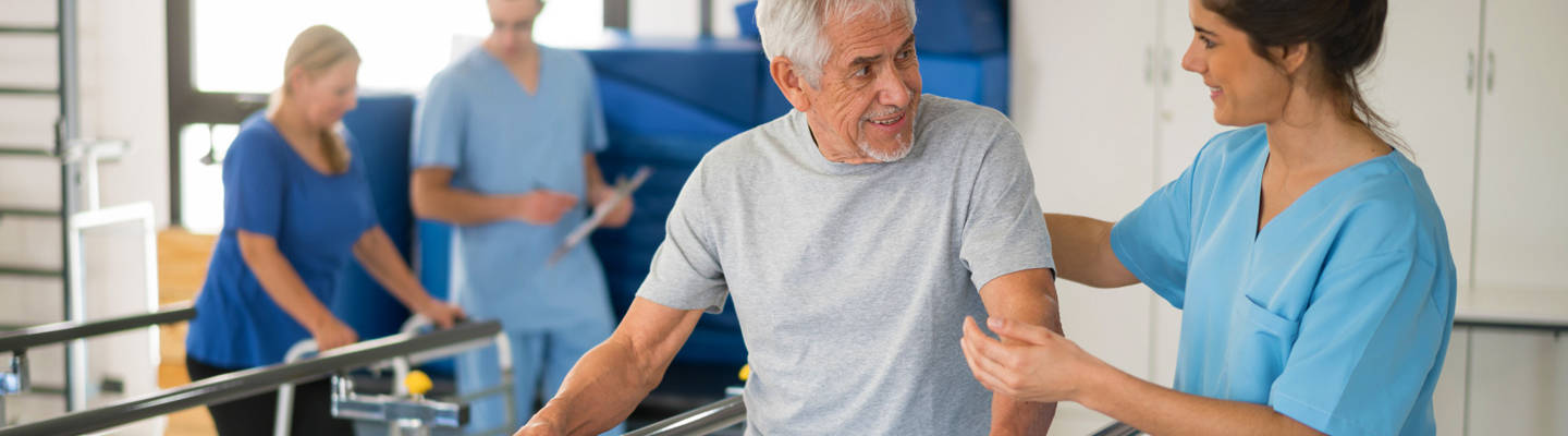 Physical therapy session with senior male