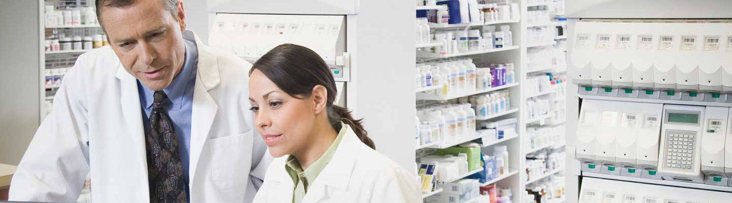2 Pharmacists looking at computer