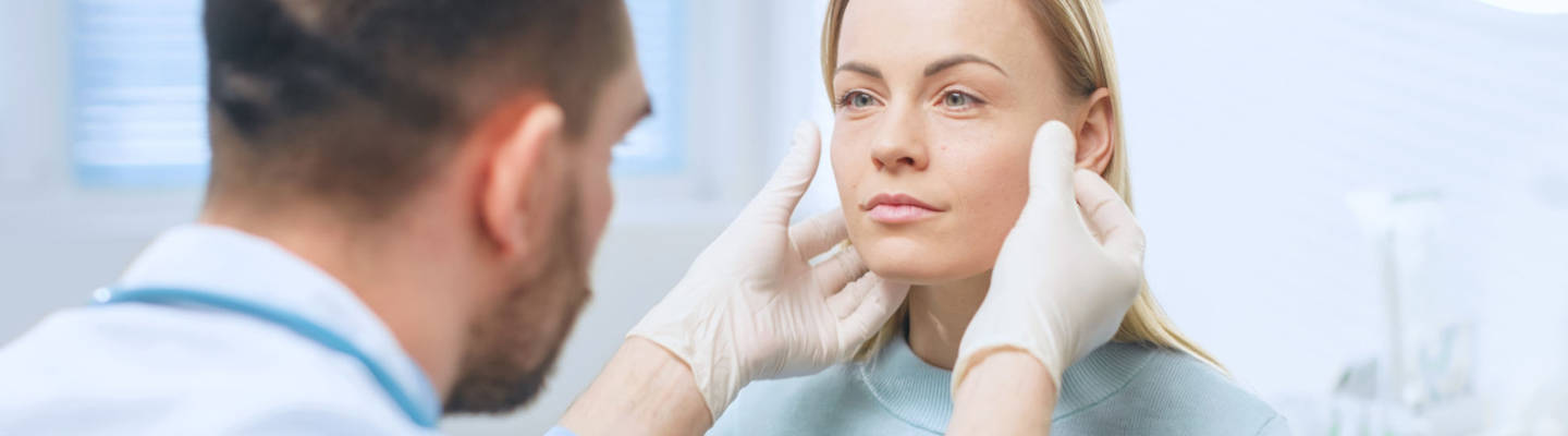 Woman consulting with plastic surgeon