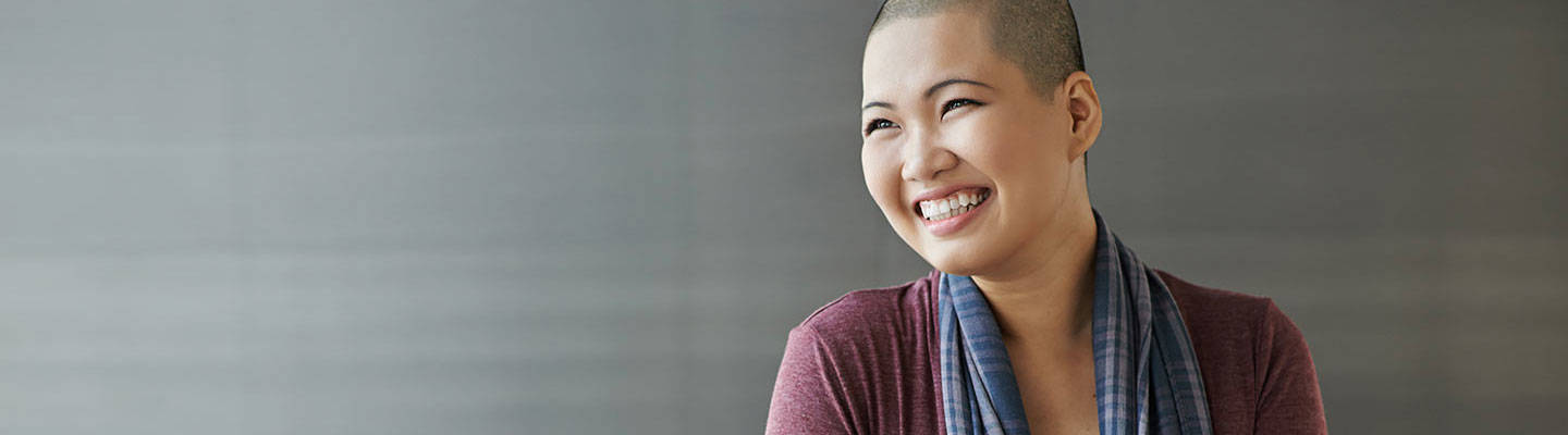 Smiling woman with bald hair