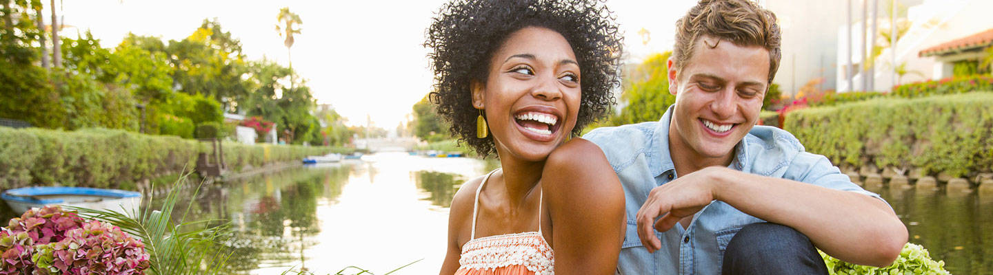 Young couple outdoors laughing