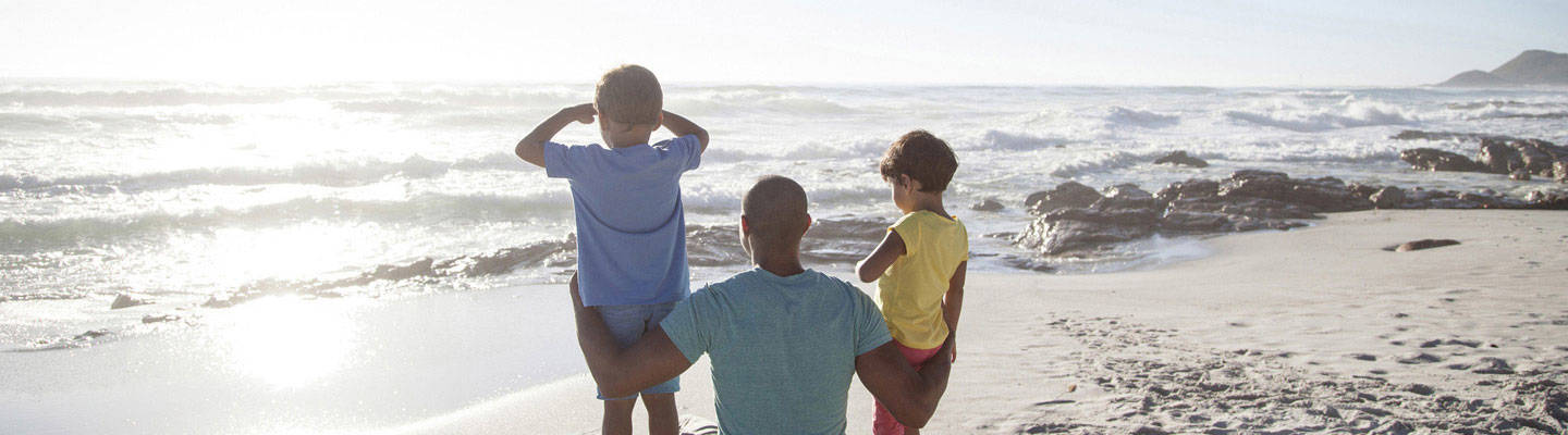 Dad with young sons watching sunrise