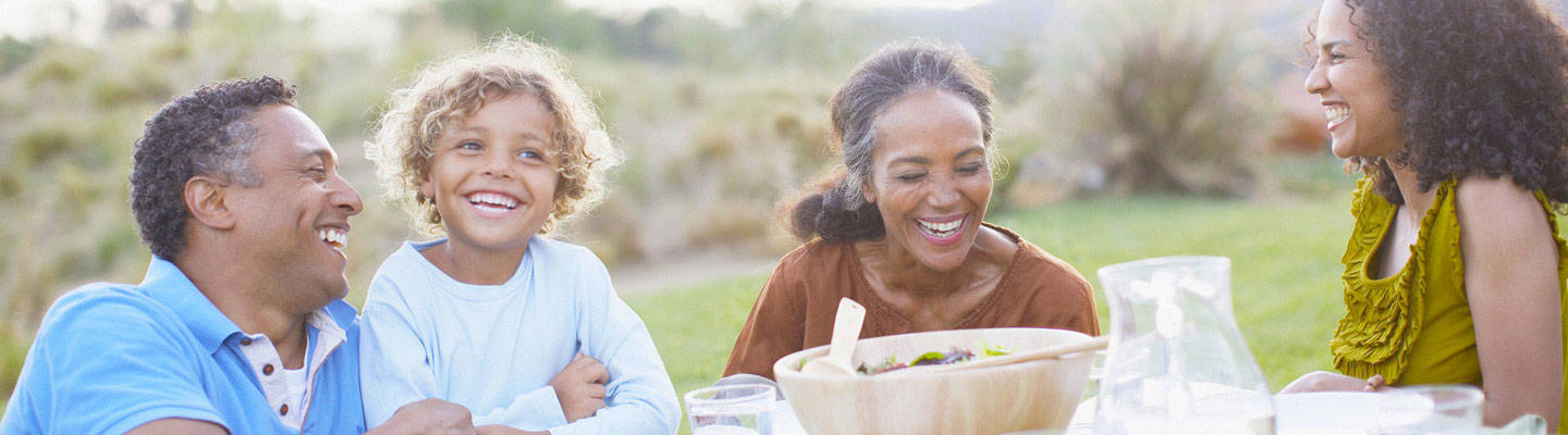 Family laughing and enjoying company over lunch