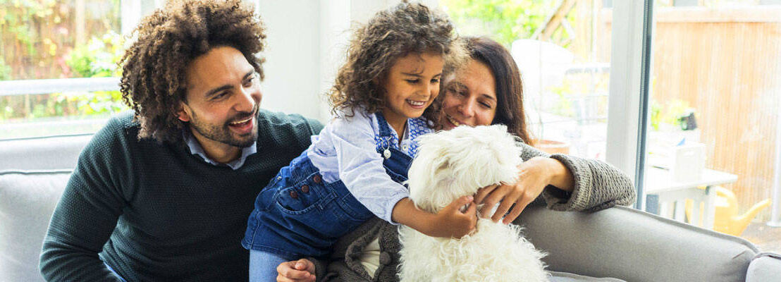 Family at home with family dog