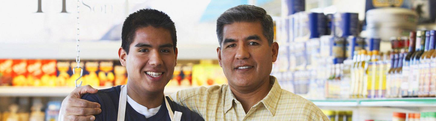 Father putting hand on son's shoulder at market
