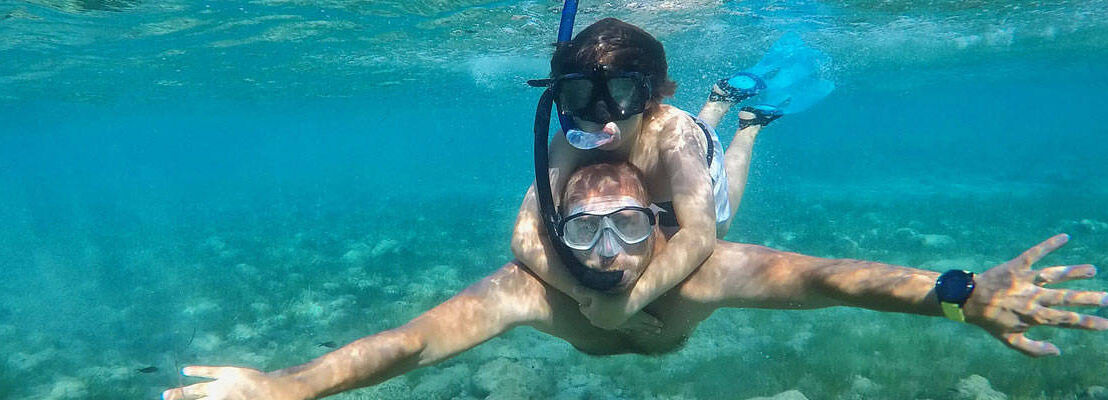 Father and son snorkling