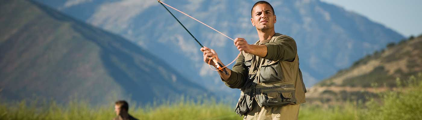 Fly fisherman in a mountain river