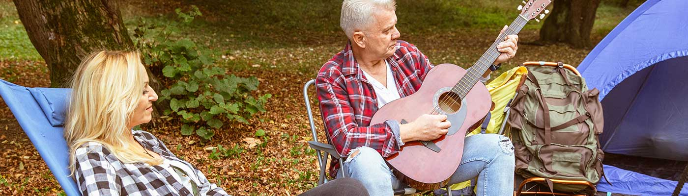 Man playing the guitar at campground