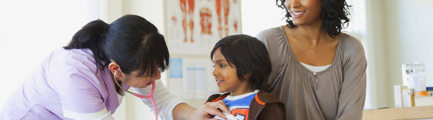 Caregiver examining a young patient at clinic