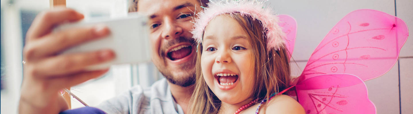 Dad taking selfie with young girl