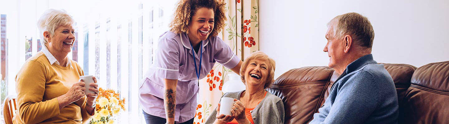 A group of seniors at retirement home with a caregiver