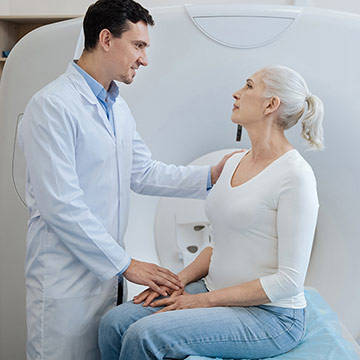 Technician explains MRI process to patient