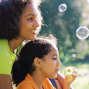 Mom and daughter blowing bubbles